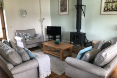 The main lounge area with woodburner