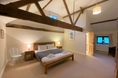 The master bedroom has a vaulted ceiling
